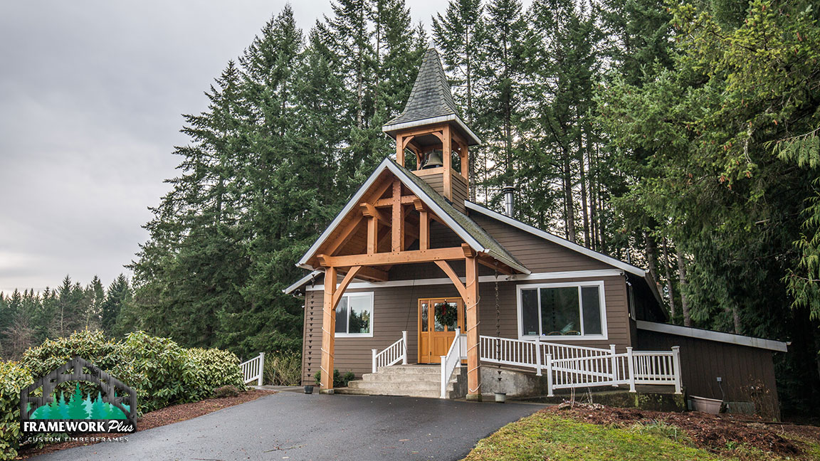 A small church with a custom entryway and steeple created by Framework Plus in Portland, OR