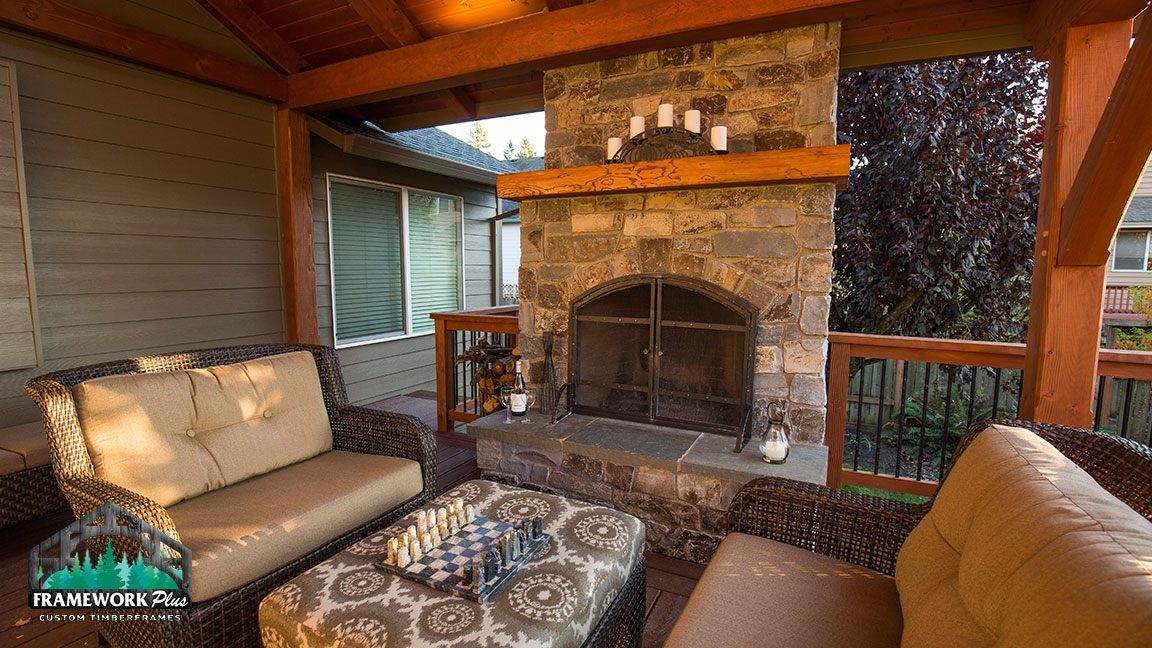 Outdoor patio design with fireplace built by Framework Plus in Portland, OR