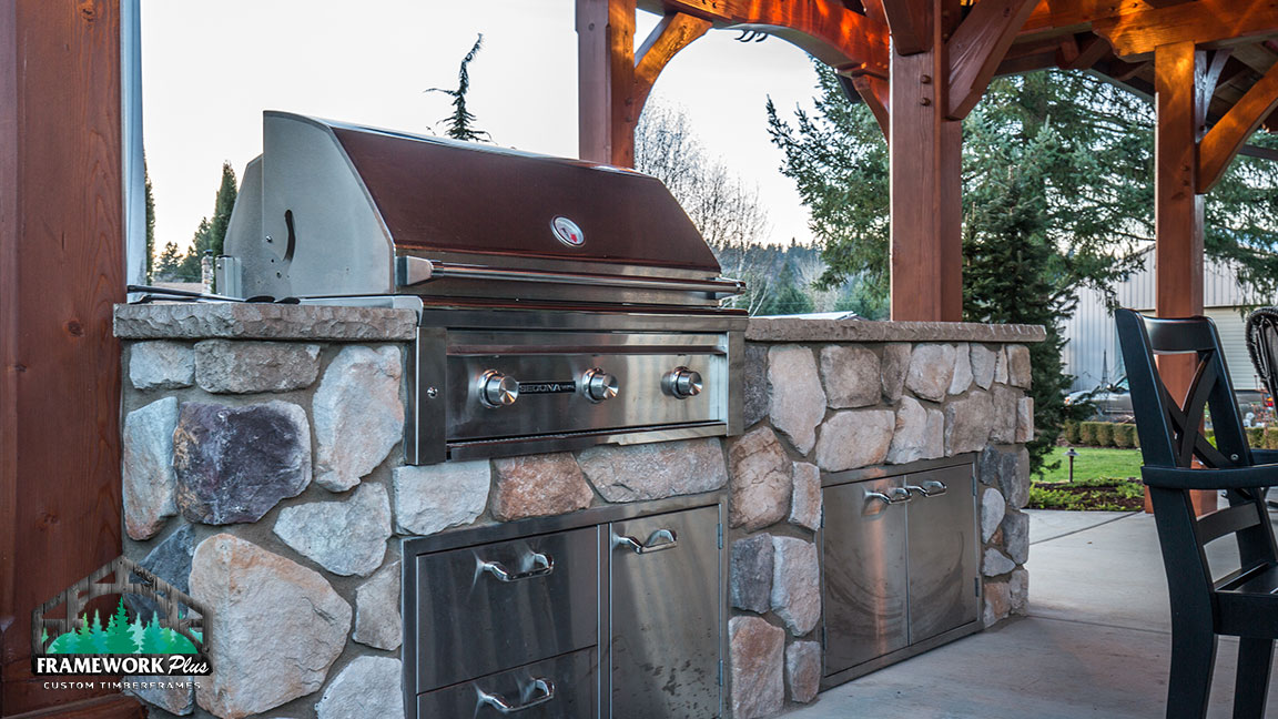 Outdoor grill inside the MT. Hood Timber Frame Pavilion built by gazebo builder Framework Plus in Portland, OR