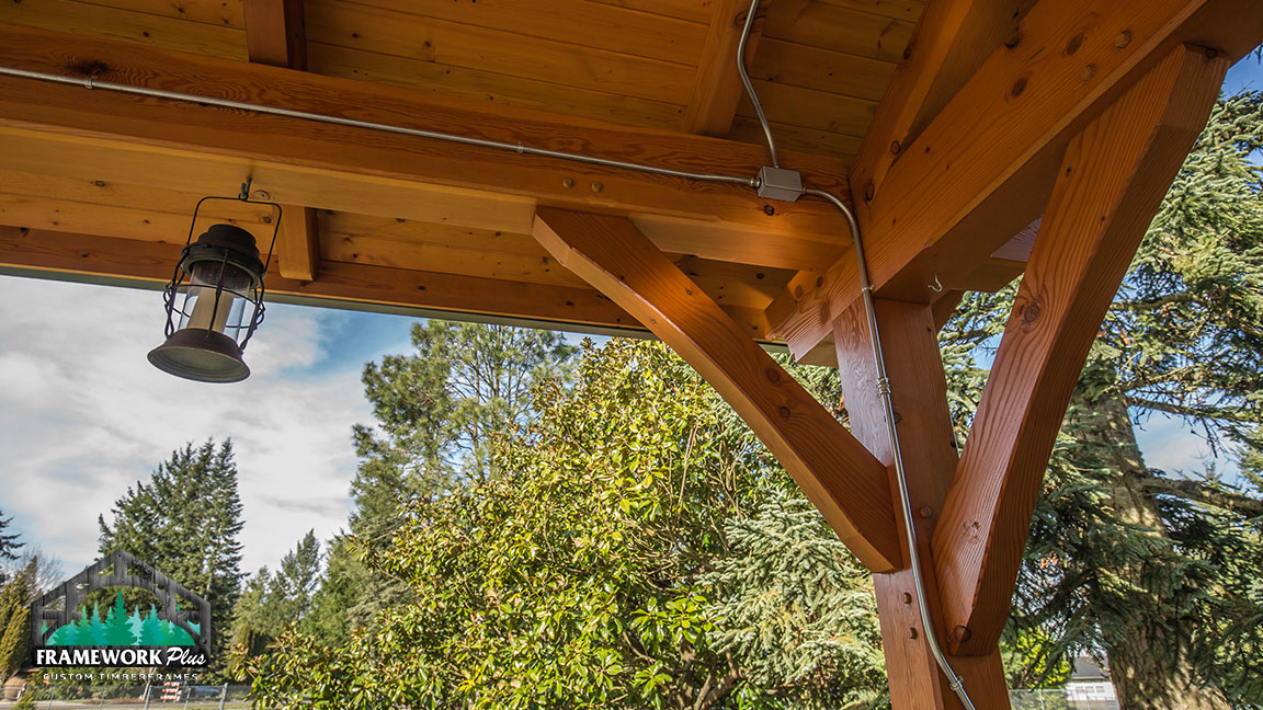 Close-up of the lantern and electric wiring inside of a Timberline pavilion kit with tongue and groove wood ceiling designed by Framework Plus in Estacada, OR