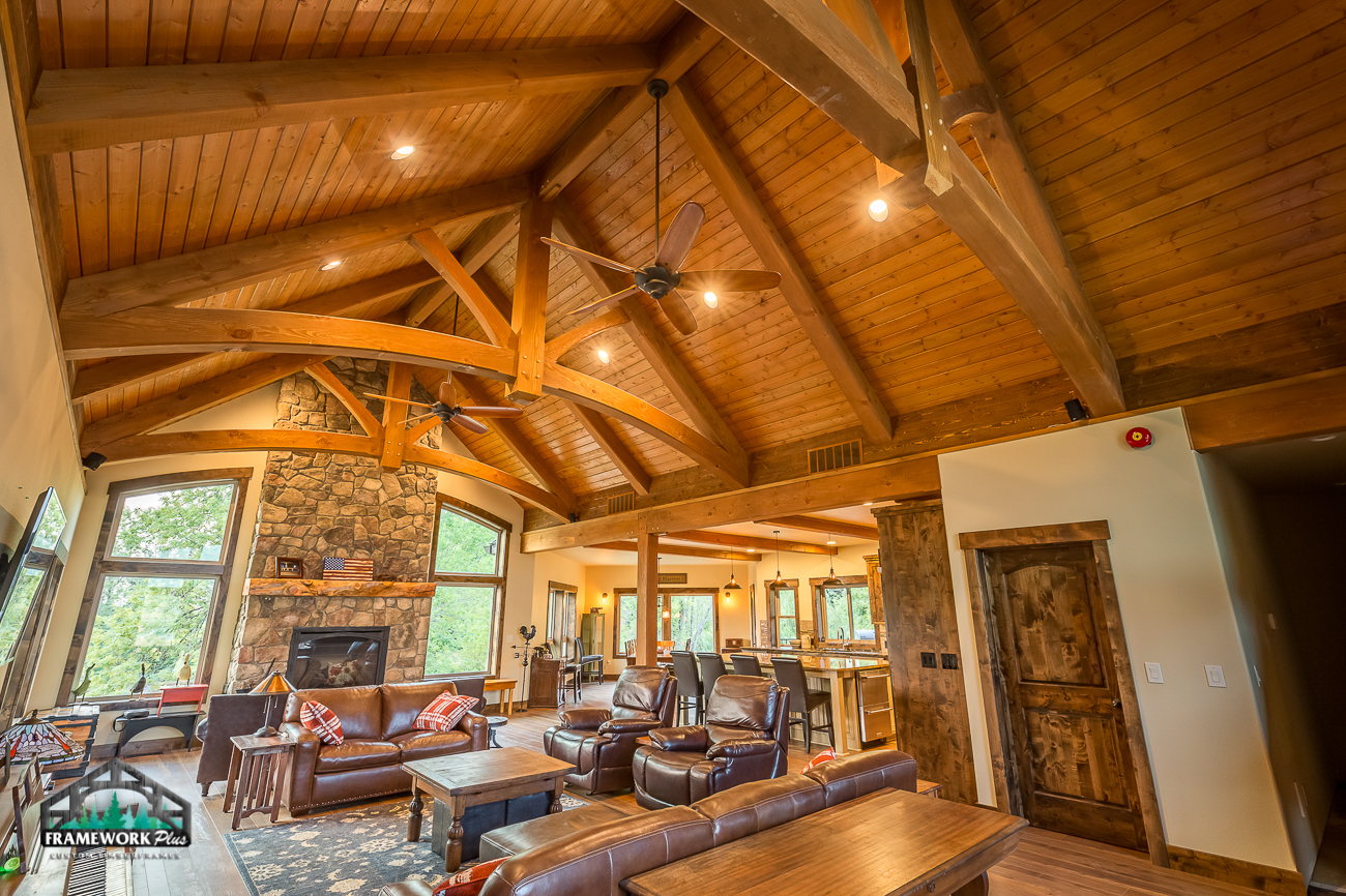 The living room of a house with custom wood ceilings and arches designed by Framework Plus in Estacada, OR