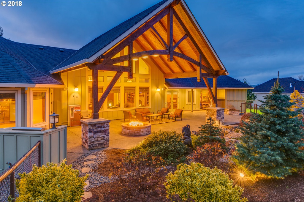 Outside nighttime view of custom outdoor patio designed by gazebo builder Framework Plus in Estacada, OR